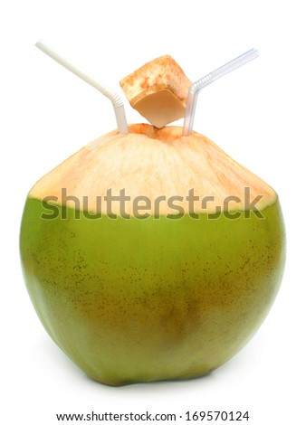 Green coconut with pipes over white background - stock photo