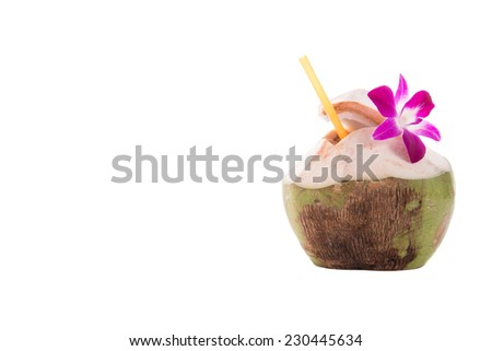 Green coconuts with drinking straw isolated