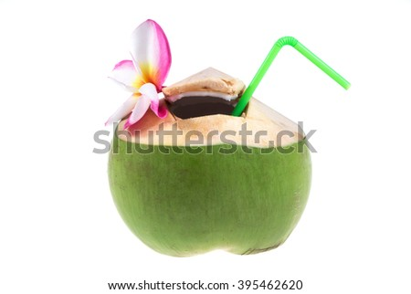 Green coconuts with drinking straw on white background - stock photo