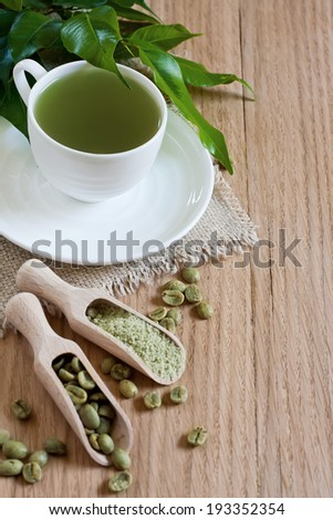 Green coffee - beans and ground. Selective focus. Copy space background. - stock photo