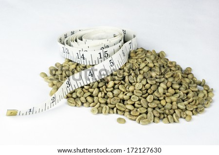 Green Coffee Beans With Tape Measure - stock photo