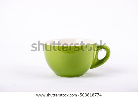 Green coffee cup on the white paper.