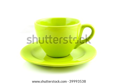Green coffee-cup with plate isolated on white background