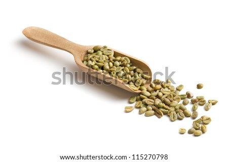 green coffee in wooden scoop on white background - stock photo