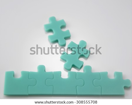 green color jigsaw puzzle on the white background