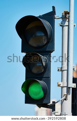 Green color on the traffic light with a beautiful blue sky in background - stock photo