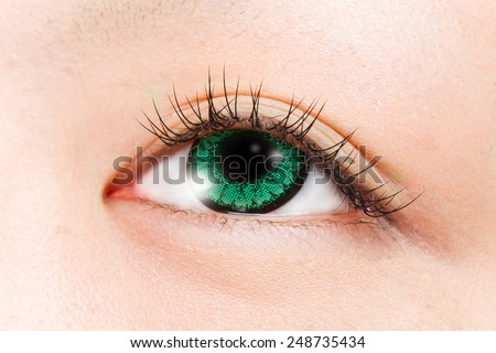 green colored contact lens asian girl eye - stock photo