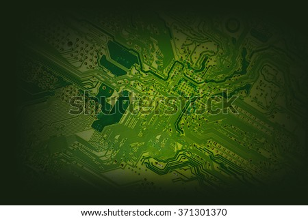 Green Computer motherboard  for background or texture add vignette filter - stock photo