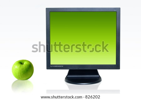Green concept - monitor and green apple