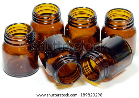 Green Concept of Reduce, Reuse and Recycle with The Amber Glass Bottles on White Background. - stock photo