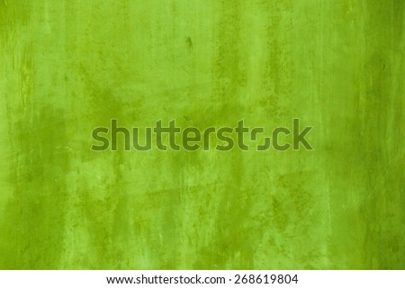 Green concrete wall background. - stock photo