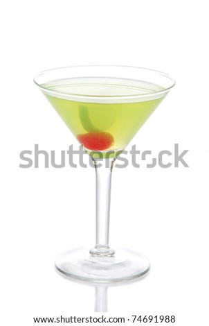 Green Cosmopolitan martini cocktail with vodka, rum,  liqueur, lemon juice, pineapple, maraschino cherry in small martinis cocktails glass isolated on a white background