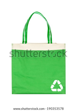 Green cotton eco bag  with recycle symbol isolated on white background