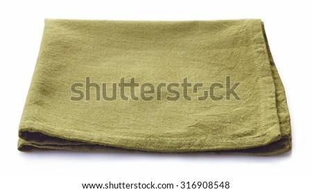 Green cotton napkin isolated on white background - stock photo