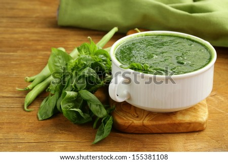 green cream soup of spinach and green peas in white bowl - stock photo
