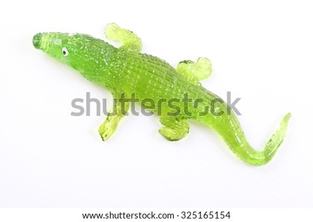 Green crocodile toy on White Background