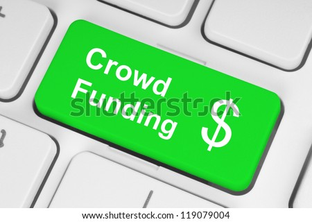 Green crowd funding button on keyboard - stock photo