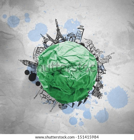 green crumpled paper and traveling around the world as concept - stock photo