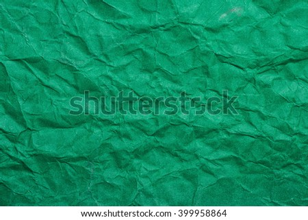 Green crumpled paper texture background - stock photo