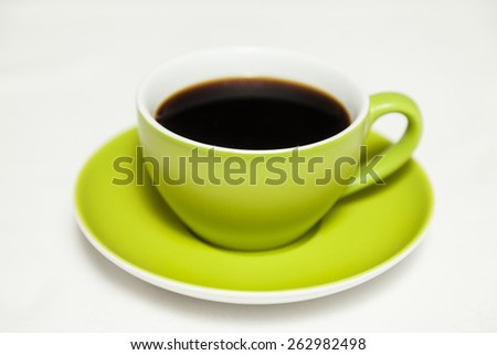 green cup of coffee on white background - stock photo