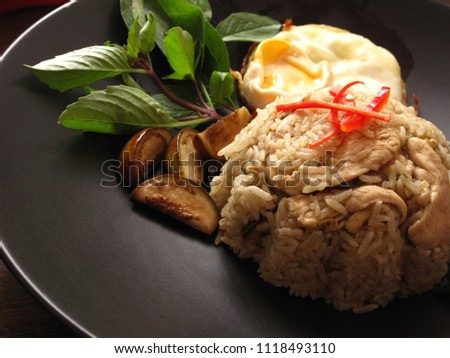 Green curry fried rice skinless chicken stock photo royalty free green curry fried rice with skinless chicken breast served with fried egg and vegetables in a ccuart Gallery