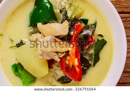 Green Curry, Thai Famous Cuisine, Popular Thai Food. Homemade Fresh Cooked. Wood Background. Selective Focus. - stock photo