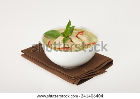Green curry thai soup with chicken meat. - stock photo