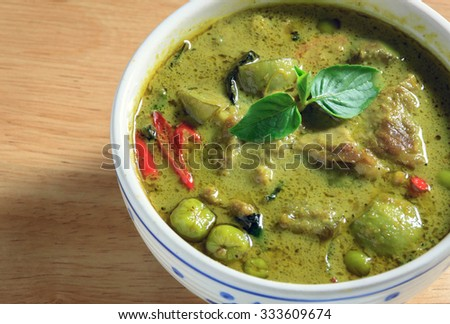 green curry wood background. - stock photo