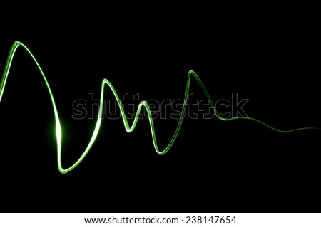 green curve - a signal on a black screen - stock photo