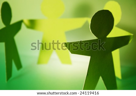 green cutouts holding hands