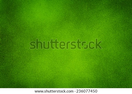 Green dark texture background with bright center spotlight - stock photo