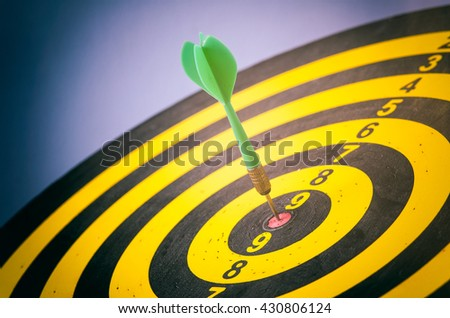 Green dart with target arrows ,business concept of target marketing. Success or Goal symbol. - stock photo