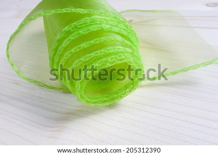 Green decoration ribbon on the table