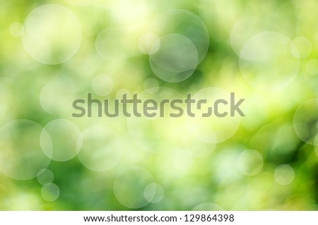 Green defocused background with bokeh bubbles - stock photo