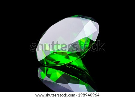 green diamond isolated on black - stock photo