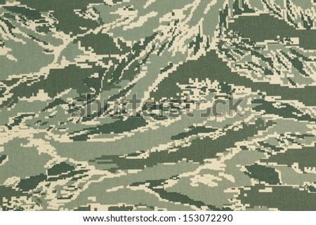 Green digital tigerstripe camouflage fabric texture background - stock photo