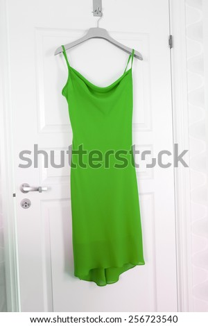 Green Dress hanging on a door - stock photo