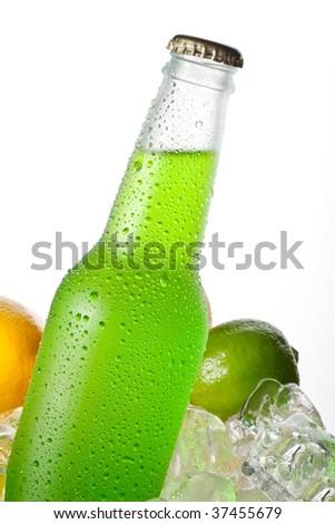 Green drink in wet glass bottle - stock photo