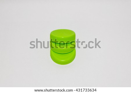 Green drinking water cap with white background isolated. can use for advertising or campaign save the world, green world are global warming. this is recycle. - stock photo