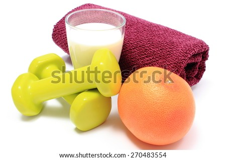 Green dumbbells and purple towel for using in fitness, fresh grapefruit and glass of milk, concept for healthy nutrition and lifestyle. Isolated on white background - stock photo