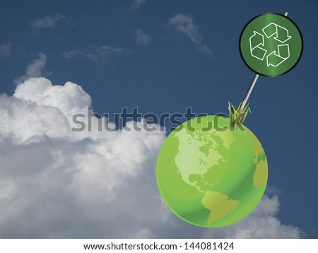 Green earth recycling sign against a cloudy blue sky - stock photo