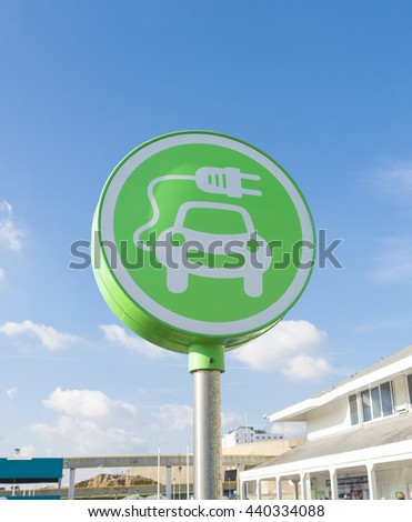 green electric car charging station symbol in Brighton, UK