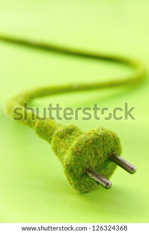 green electric plug , save energy concept - stock photo