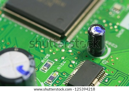 Green electronic PCB circuit background ,close up microchip CPU and component  electronic circuit board. electronics and IT technology manufacturing and business texture background