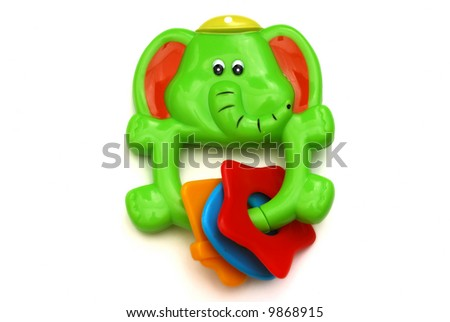 green elephant rattle isolated on white - stock photo