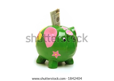 Green elephant shaped bank with money in slot