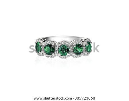 green emerald and diamond wedding band ring - stock photo