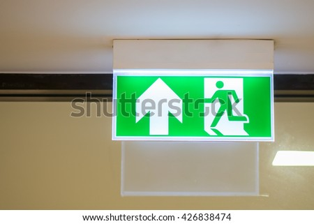 Green emergency exit badge