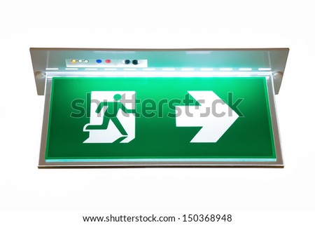 green emergency exit sign showing the way to escape - stock photo
