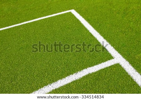 green empty football soccer field with corner under daily light - stock photo